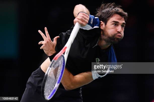 Jeremy Chardy of France serves during his first round match against Fernando Verdasco of Spain during Day Two of the Rolex Paris Masters at...