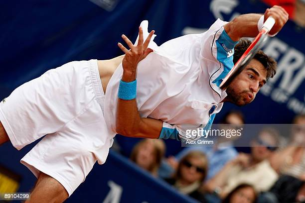 Jeremy Chardy of France serves the ball to Victor Hanescu of Romania during the final match of the MercedesCup at the TC Weissenhof on July 19 2009...