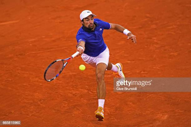 Jeremy Chardy of France stretches to hit a forehand during the singles match against Daniel Evans of Great Britain on day one of the Davis Cup World...