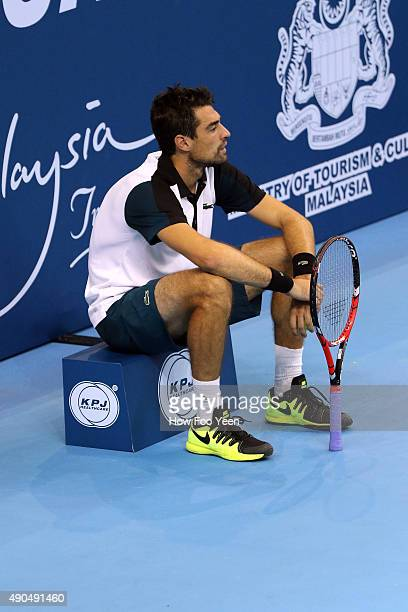 Jeremy Chardy of France waits while Alexander Zverev of Germany seeks treatmen during the 2015 ATP Malaysian Open at Bukit Jalil National Stadium on...