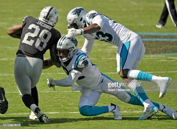 Jeremy Chinn and Brian Burns of the Carolina Panthers tackle Josh Jacobs of the Las Vegas Raiders at Bank of America Stadium on September 13, 2020 in...