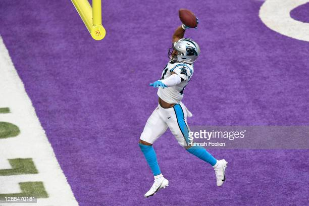 Jeremy Chinn of the Carolina Panthers celebrates after recovering a fumble by Kirk Cousins of the Minnesota Vikings and returning it for a touchdown...