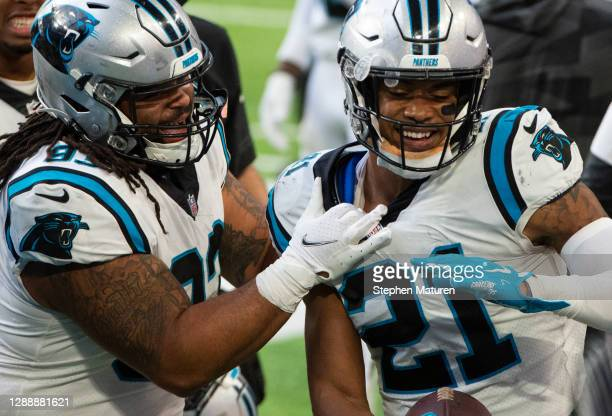 Jeremy Chinn of the Carolina Panthers celebrates scoring a touchdown on a turnover in the third quarter of the game against the Minnesota Vikings at...