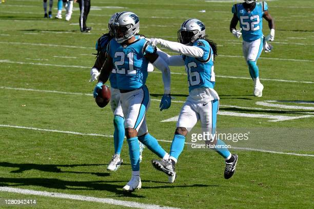 Jeremy Chinn of the Carolina Panthers celebrates with teammates after making an interception in the third quarter against the Chicago Bears at Bank...