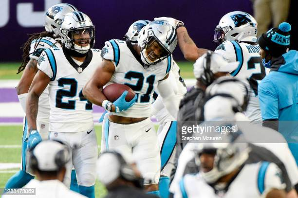 Jeremy Chinn of the Carolina Panthers celebrates with teammates after recovering a fumble by Kirk Cousins of the Minnesota Vikings and returning it...