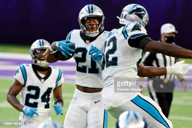 Jeremy Chinn of the Carolina Panthers celebrates with teammates after recovering a fumble by Dalvin Cook of the Minnesota Vikings and returning it...