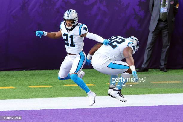 Jeremy Chinn of the Carolina Panthers celebrates with Zach Kerr after recovering a fumble by Dalvin Cook of the Minnesota Vikings and returning it...