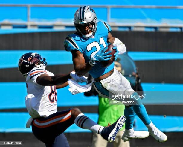 Jeremy Chinn of the Carolina Panthers intercepts a pass in front of Demetrius Harris of the Chicago Bears in the third quarter at Bank of America...
