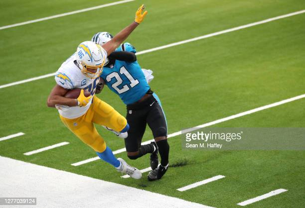 Jeremy Chinn of the Carolina Panthers pushes Hunter Henry of the Los Angeles Chargers out of bounds on a pass play during the second half of a game...