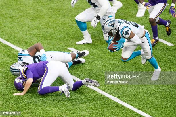 Jeremy Chinn of the Carolina Panthers recovers a fumble by Kirk Cousins of the Minnesota Vikings and returns it for a touchdown during the third...