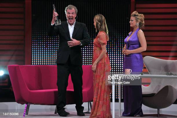 Jeremy Clarkson gestures as he receives the 2012 Honorary Rose Award for Top Gear as Isabel Lucas and host Barbara Schoeneberger look on during the...
