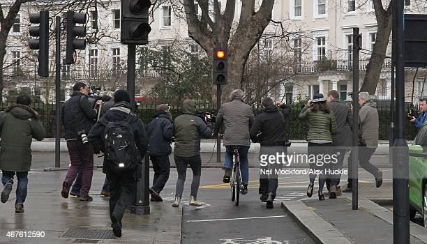 Jeremy Clarkson leaving his house on a bike followed by members of the media on March 26, 2015 in London, England.