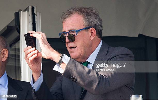 Jeremy Clarkson takes a picture while watching the races during Gold Cup day of The Cheltenham Festival at Cheltenham Racecourse on March 14 2014 in...