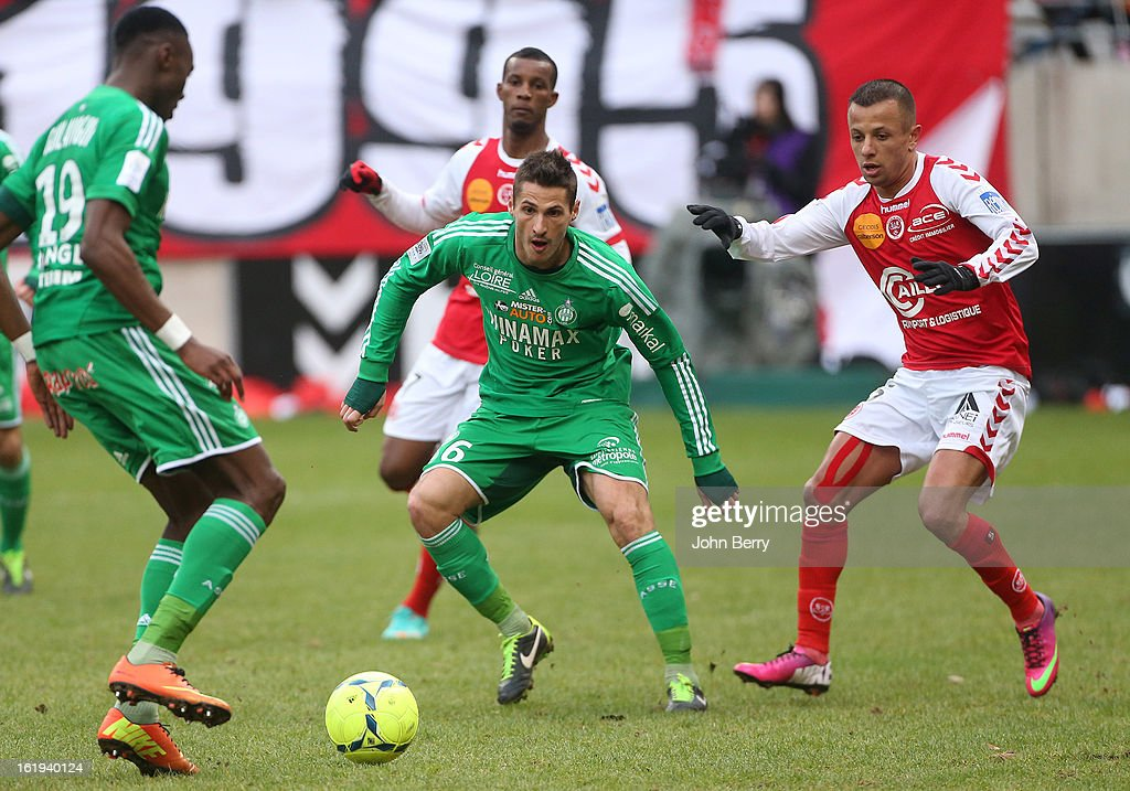 Jeremy Clement of ASSE and Kamel Ghilas of Reims in action during the french Ligue 1 match between Stade de Reims and AS Saint-Etienne at the Stade Auguste Delaune on February 17, 2013 in Reims, France.