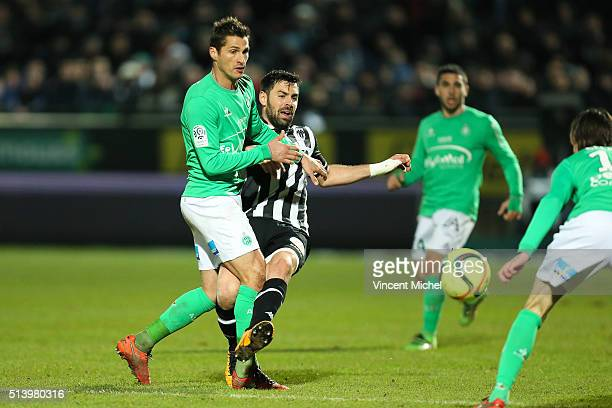 Jeremy Clement of SaintEtienne and Thomas Mangani of Angers during the French Ligue 1 match between Angers SCO v AS SaintEtienne at Stade JeanBouin...