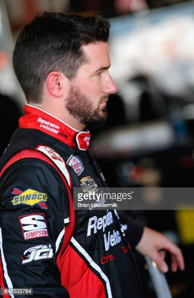 Jeremy Clements driver of the RepairableVehiclescom Chevrolet stands in the garage area during practice for the NASCAR XFINITY Series TheHousecom 300...