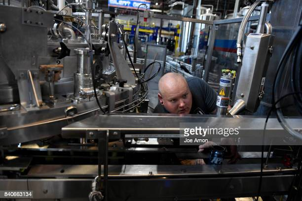 Jeremy Connelly packaging supervisor of the Oskar Blues staff setting up a Liquid Nitrogen Doser that will firm up the cans of water as the company...