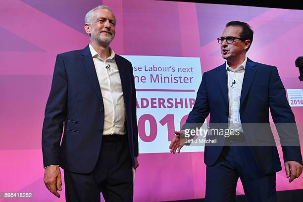 Jeremy Corbyn and Owen Smith shake hands following a Labour Party leadership debate on August 25 2016 in Glasgow Scotland Jeremy Corbyn and Owen...