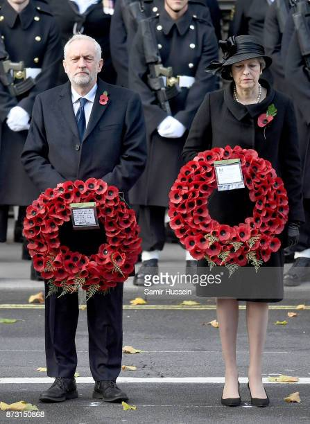 Jeremy Corbyn and PM Theresa May during the annual Remembrance Sunday Service at The Cenotaph on November 12 2017 in London England