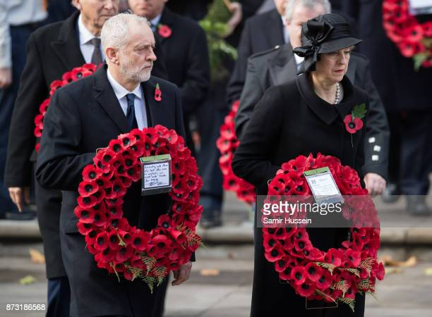 Jeremy Corbyn and Theresa May during the annual Remembrance Sunday Service at The Cenotaph on November 12 2017 in London England