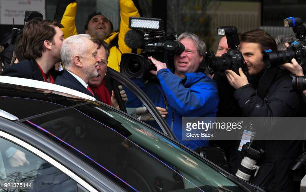 Jeremy Corbyn arrives to deliver a speech as media try for photos and interviews at The Queen Elizabeth II Conference Centre on February 20 2018 in...