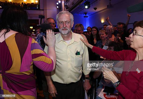 Jeremy Corbyn is greeted by supporters as he arrives to attend a Labour party leadership rally on August 3 2015 in London England Candidates are...