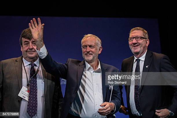 Jeremy Corbyn Leader of Labour Party stands between Tony Woodhouse Unite executive council chair and Len McCluskey General Secretary of Unite whilst...
