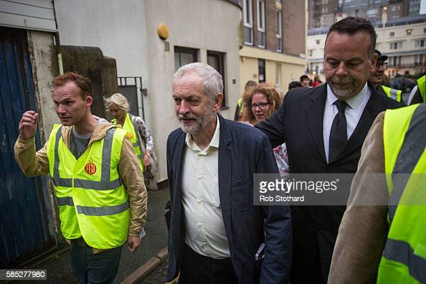 Jeremy Corbyn Leader of the Labour Party is escorted through Brighton after speaking to supporters in Regency Square on August 2 2016 in Brighton...