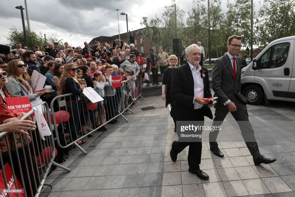 Jeremy Corbyn, leader of the U.K. opposition Labour Party, center, arrives to speak at a general-election campaign rally in Watford, U.K., on Wednesday, June 7, 2017. The prime minister Theresa May and Corbyn, set out on whistle-stop tours of the country ahead of Thursday's vote, with polls all showing May's Conservatives ahead but disagreeing about whether the race is close.r. Photographer: Simon Dawson/Bloomberg via Getty Images