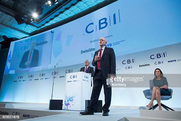 Jeremy Corbyn leader of the UK opposition Labour Party center speaks as Paul Drechsler president of the Confederation of British Industry left and...