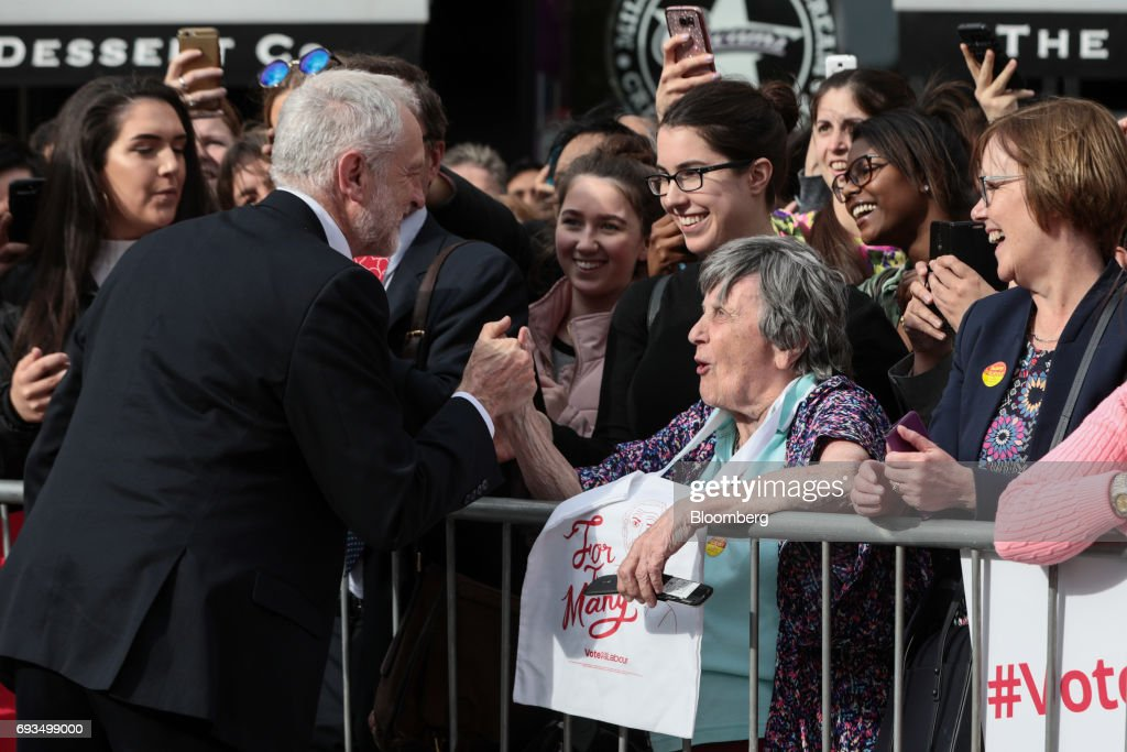 Jeremy Corbyn, leader of the U.K. opposition Labour Party, left, shakes hands with an attendee during a general-election campaign rally in Watford, U.K., on Wednesday, June 7, 2017. The prime minister Theresa May and Corbyn, set out on whistle-stop tours of the country ahead of Thursday's vote, with polls all showing May's Conservatives ahead but disagreeing about whether the race is close.r. Photographer: Simon Dawson/Bloomberg via Getty Images