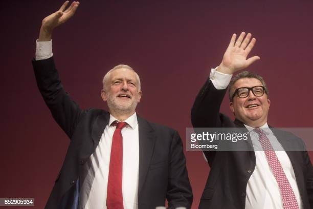Jeremy Corbyn leader of the UK opposition Labour Party left waves with Tom Watson deputy leader as they arrive on stage at the Labour Party Annual...