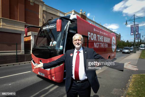 Jeremy Corbyn leader of the UK opposition Labour Party poses for photographs with his campaign bus for the UK General Election campaign in Manchester...