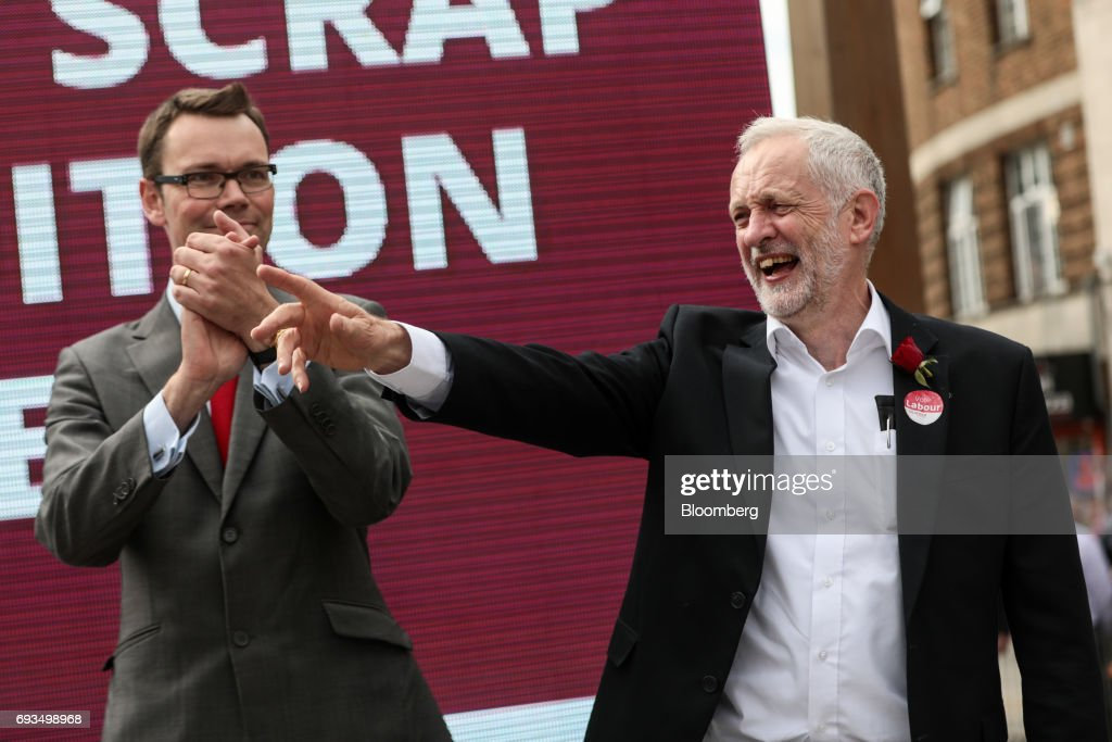 Jeremy Corbyn, leader of the U.K. opposition Labour Party, right, gestures as Chris Ostrowski, local Labour Party candidate, looks on during a general-election campaign rally in Watford, U.K., on Wednesday, June 7, 2017. The prime minister Theresa May and Corbyn, set out on whistle-stop tours of the country ahead of Thursday's vote, with polls all showing May's Conservatives ahead but disagreeing about whether the race is close.r. Photographer: Simon Dawson/Bloomberg via Getty Images