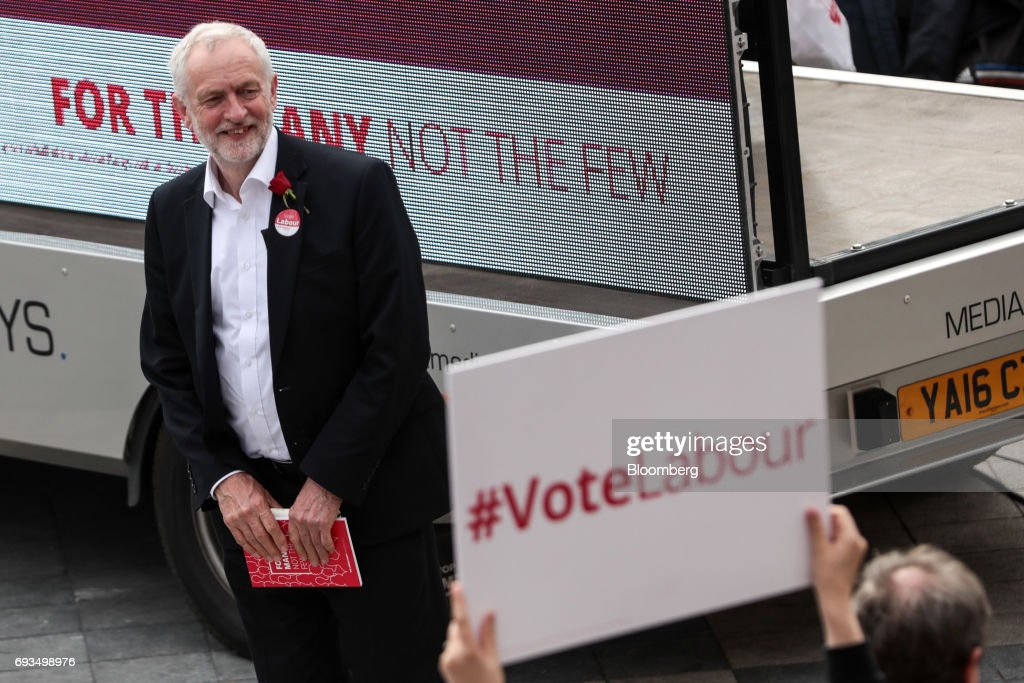 Jeremy Corbyn, leader of the U.K. opposition Labour Party, waits to speak during a general-election campaign rally in Watford, U.K., on Wednesday, June 7, 2017. The prime minister Theresa May and Corbyn, set out on whistle-stop tours of the country ahead of Thursday's vote, with polls all showing May's Conservatives ahead but disagreeing about whether the race is close.r. Photographer: Simon Dawson/Bloomberg via Getty Images