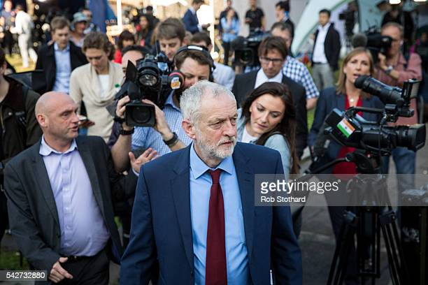 Jeremy Corbyn MP leader of the Labour Party is followed by journalists as he walks towards the Houses of Parliament on June 24 2016 in London United...