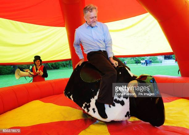 Jeremy Corbyn MP rides a mechanical bull in support of Friends of the Earth's planet friendly farming campaign in Victoria Tower Gardens Millbank...