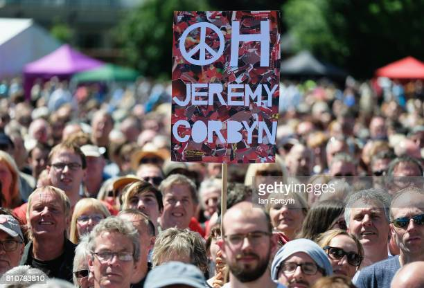 Jeremy Corbyn placard is held above the heads of the crowd during the 133rd Durham Miners Gala on July 8 2017 in Durham England Over two decades...