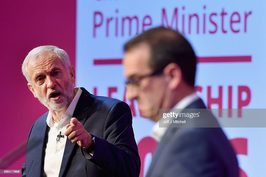 Jeremy Corbyn points as Owen Smith looks on during a Labour Party leadership debate on August 25, 2016 in Glasgow,Scotland. Jeremy Corbyn and Owen Smith are going head to head in a debate at the SECC, the hustings event is part of a series organised for the Labour leadership election campaign and is the only one to be taking place in Scotland.