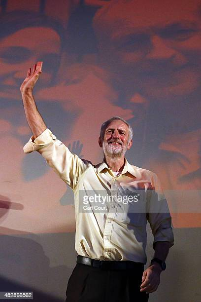 Jeremy Corbyn raises his arms as he is applauded following a speech at a Labour party leadership rally on August 3 2015 in London England Candidates...