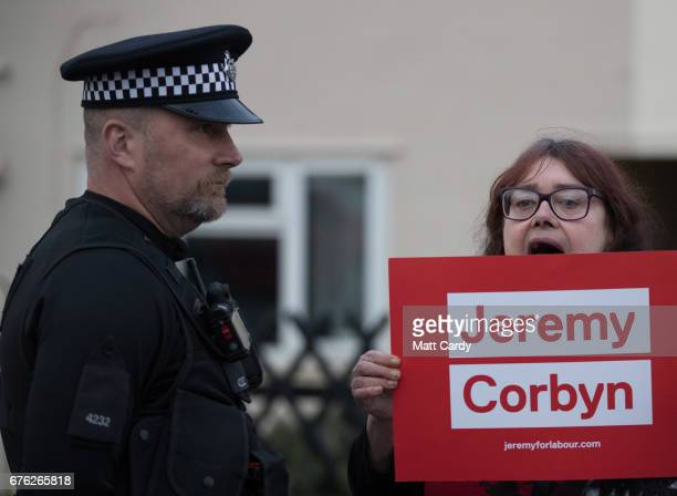 Jeremy Corbyn supporter holds up a sign as Britain's Prime Minister Theresa May makes a campaign stop on May 2 2017 in Bristol England The Prime...