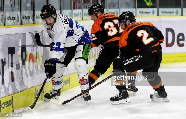 Jeremy Dehner of Wolfsburg and Mitchell Heard of Straubing battle for the puck during the DEL match between Grizzlys Wolfsburg and Straubing Tigers...