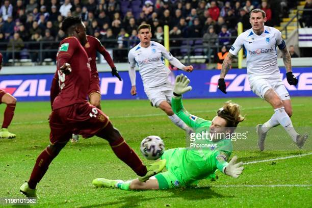 Jeremy Doku forward of Anderlecht battles for the ball with Maarten Vandevoordt goalkeeper of Genk during the Jupiler Pro League match between RSC...