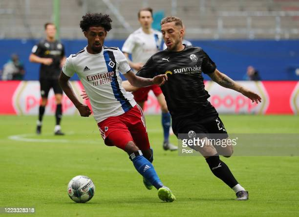Jeremy Dudziak of Hamburger SV is challenged by Robin Scheu of SV Sandhausen during the Second Bundesliga match between Hamburger SV and SV...