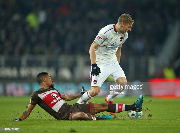 Jeremy Dudziak of St Pauli and Hanno Behrens of Nuernberg battle for the ball during the Second Bundesliga match between FC St Pauli and 1 FC...