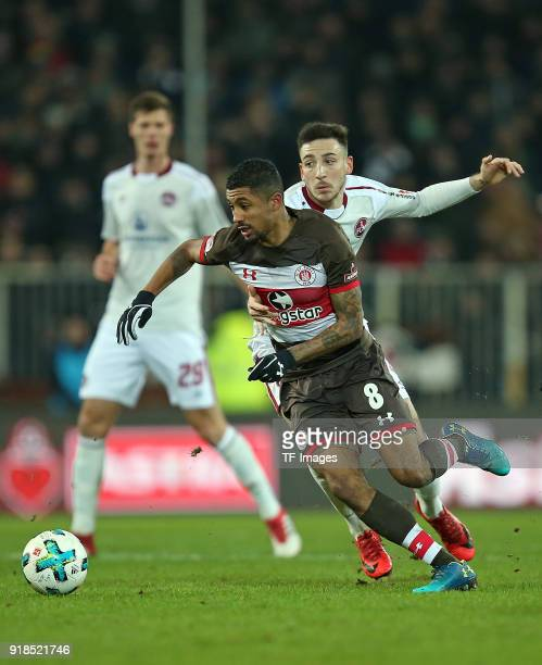 Jeremy Dudziak of St Pauli and Kevin Moehwald of Nuernberg battle for the ball during the Second Bundesliga match between FC St Pauli and 1 FC...