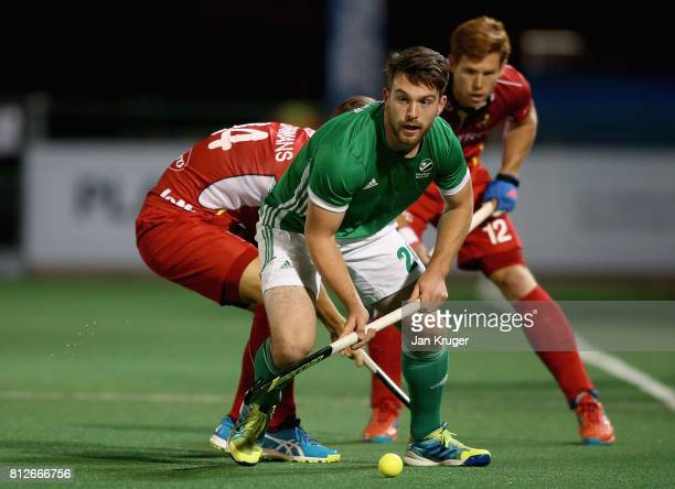 Jeremy Duncan of Ireland and Augustin Meurmans of Belgium in action during day 2 of the FIH Hockey World League Semi Finals Pool B match between...