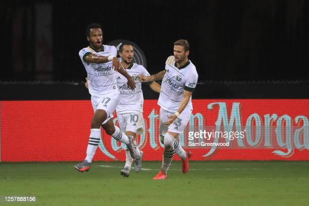 Jeremy Ebobisse of Portland Timbers celebrates with teammates Sebastian Blanco and Dario Zuparic after to tie 2-2 during a match between Los Angeles...
