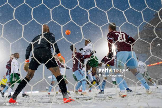 Jeremy Ebobisse of Portland Timbers reaches for a header over Benny Feilhaber of Colorado Rapids during the second half at Dick's Sporting Goods Park...