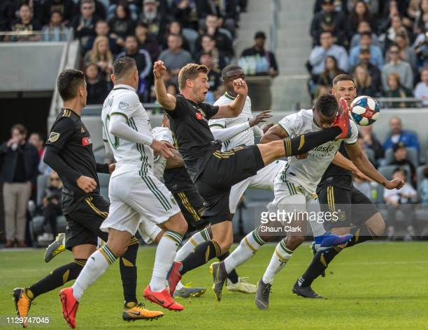 Jeremy Ebobisse of Portland Timbers scores a goal as Walker Zimmerman of Los Angeles FC defends during Los Angeles FC's MLS match against Portland...